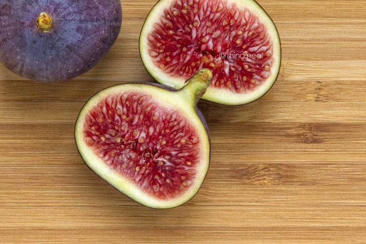 fresh figs on a chopping board - image for sale on Getty Images http://www.gettyimages.co.uk/Search/Search.aspx?assettype=image&family=creative&artist=copyright+rhinoneal#