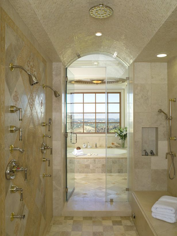Matt Muenster's 12 Master Bath Remodeling Must-Haves: Designer Lori Dennis added storage shelves, bench seating and multiple shower heads to turn this shower into a room of its own. From DIYnetwork.com