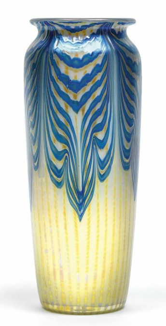 A vase,  Loetz Witwe, Klostermühle, c. 1900, Phänomen pattern, the colourless glass cased in white opalescence, on the outside decorated with vertical silver-yellow bands that have been divided into rows of dots with the aid of a rib mould, the upper half covered with silver veined blue bands pulled into a regular pattern, iridescence, height 22 cm