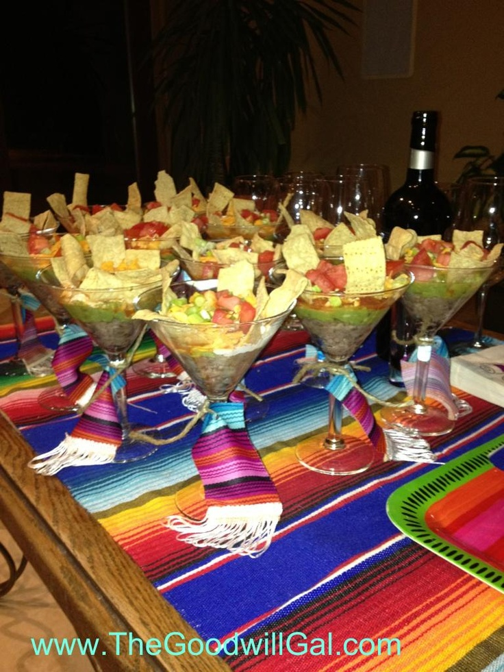 Martini glasses from Goodwill are perfect for this handheld Mexican dip appetizer.