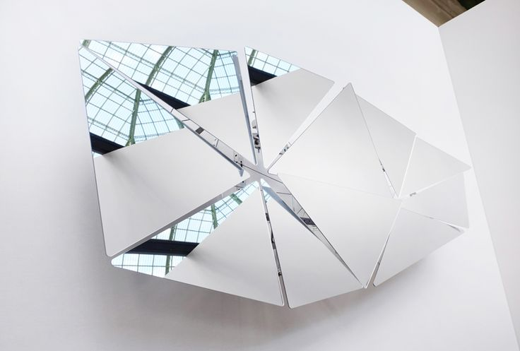 French artist Vincent Leroy brings back his stone age glass installation piece with a finer twist. composed of eleven reflective pieces, the structure is displayed right under the Grand Palais in the Champs Élysées, Paris, with a bigger and more striking volume.