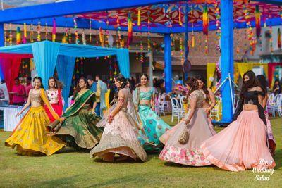 Bridesmaids dancing on mehendi with bride