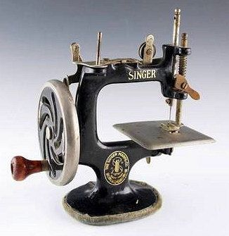 This 1940s antique mini Singer sewing machine still works! Mostly popular in the 40's, these small sewing machines were intended for children but also became popular as a light and portable sewing machine for adults. There were other manufacturers of these but none as popular or as well made and dependable as Singer.