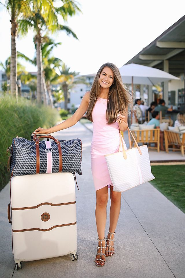 cute airport outfit and luggage