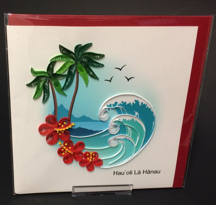 """""""Happy Birthday"""" card in Hawaiian with a beach scene, with palm trees, waves and red hibiscus flowers."""