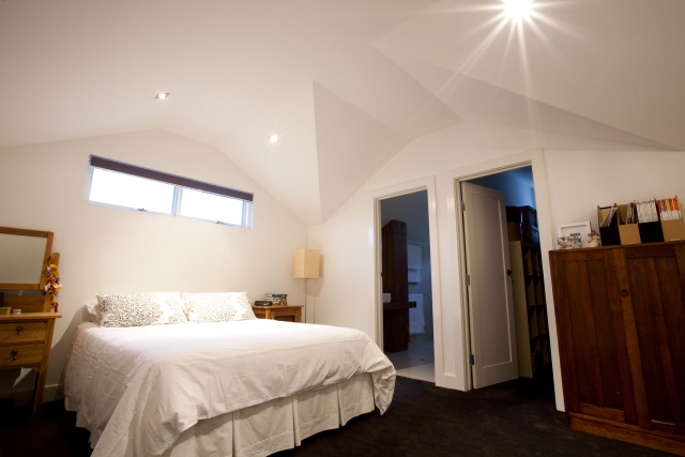 Master Bedroom built into roof cavity upstairs. Ensuite & WIR constructed to the rear.