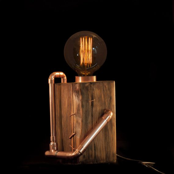 Base of lamp is made from old, reclaimed pine wood with beautiful wood texture. Shaped and smoothed by hands tools.  110V-250 V, E27 light