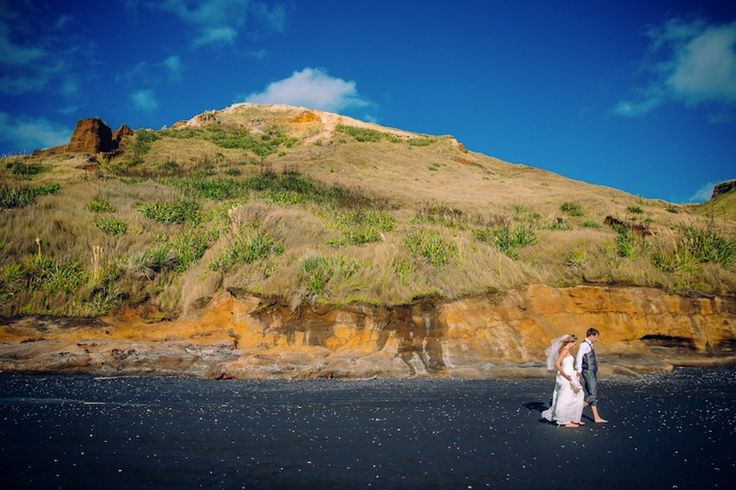 Breath-taking image of the Bride and Groom who tied the knot at one of Aucklands most stunning ocean front wedding venues - Castaway Resort | Photo by Threetwentythree photography | Truly & Madly Stories | New Zealand real wedding stories