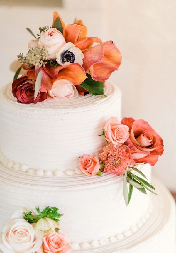 Rose adorned pink two-tier wedding cake | image by  Kelly Pratt Photography