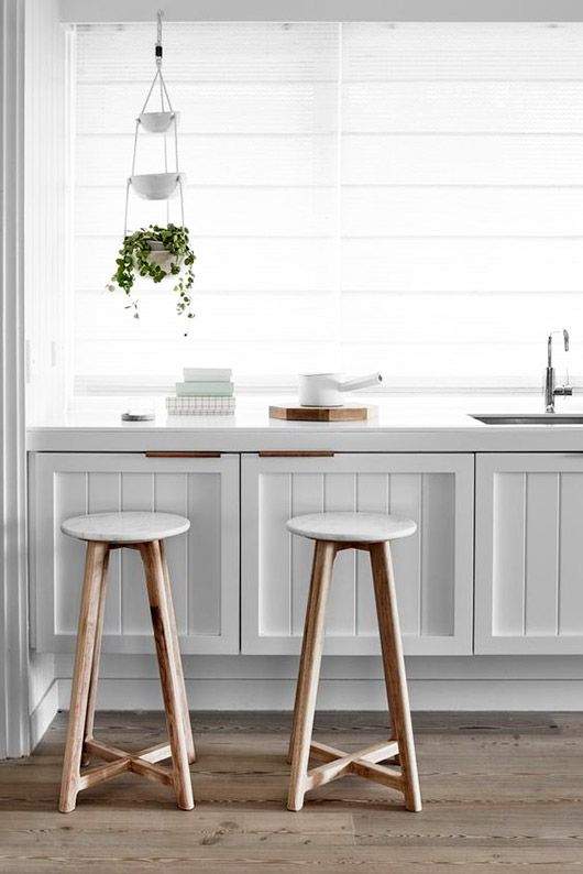 wood and marble stools by harpers project in modern white kitchen / sfgirlbybay