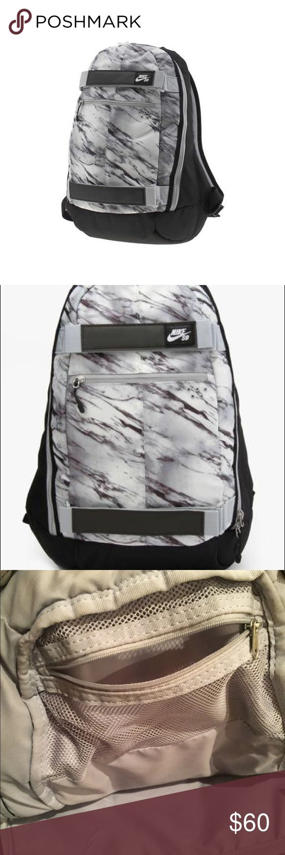 NIKE Marble Backpack This Nike SB marble print backpack is STUNNING! You're sure to be the most stylish on campus or in the halls with this amazing backpack! The backpack features a laptop pocket on the inside, a small zipper pocket on the outside and another small zipper pocket on the inside perfect for pens and pencils! Nike Bags Backpacks