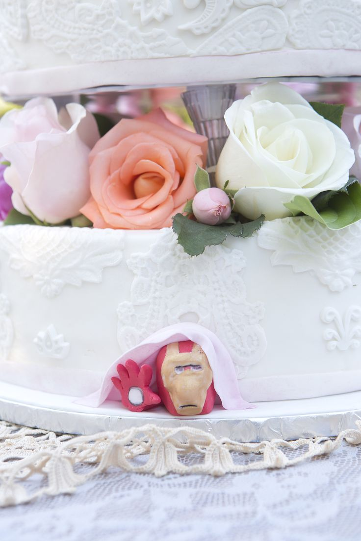 40's vintage themed wedding. Iron man poking out of the bottom of the cake.