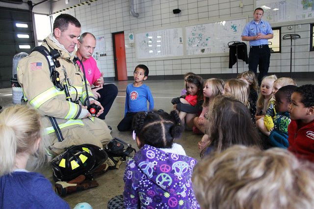 Firefighters Cale Doyle and Wes Hubbard answer student questions during a tour of the fire station. Photo by Sarina Rhinehart/Ames Tribune  http://amestrib.com/news/fire-prevention-week