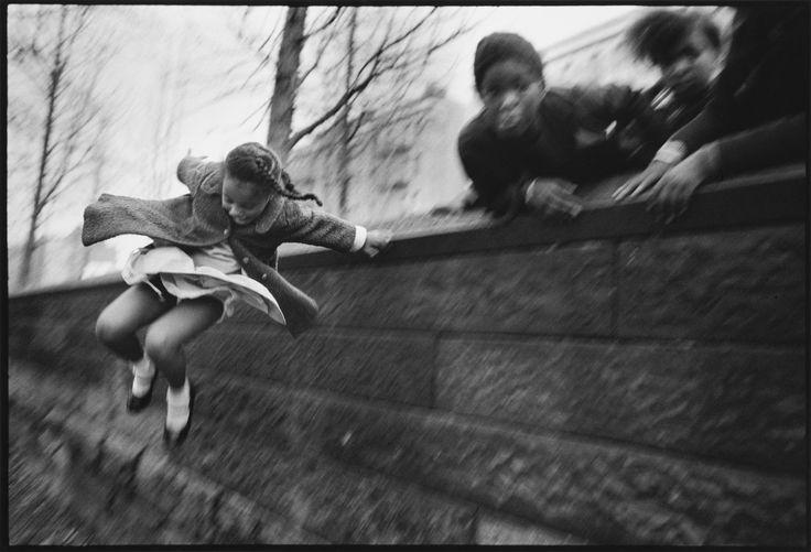 Mary Ellen Mark's legendary photographs – iGirl jumping over a wall, Central Park, New York, 1967