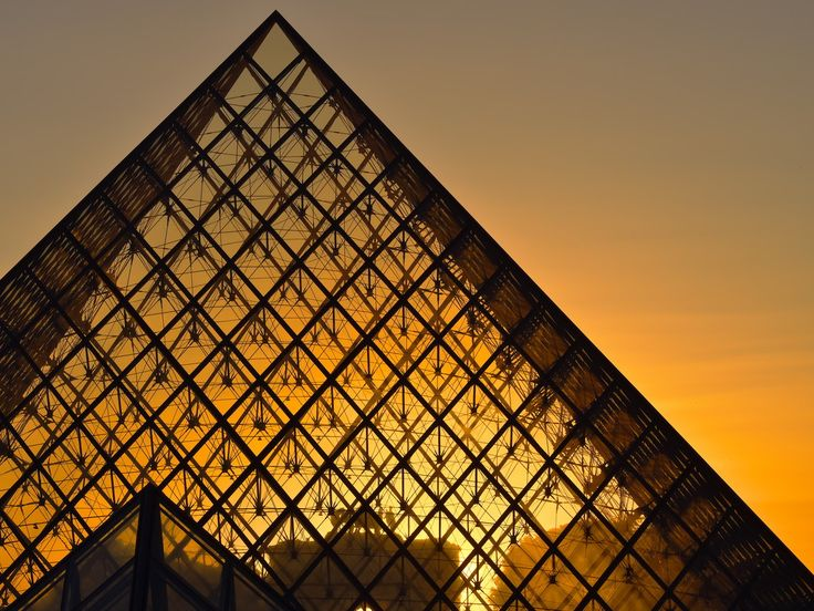 Louvre's pyramid and sunset by nme94