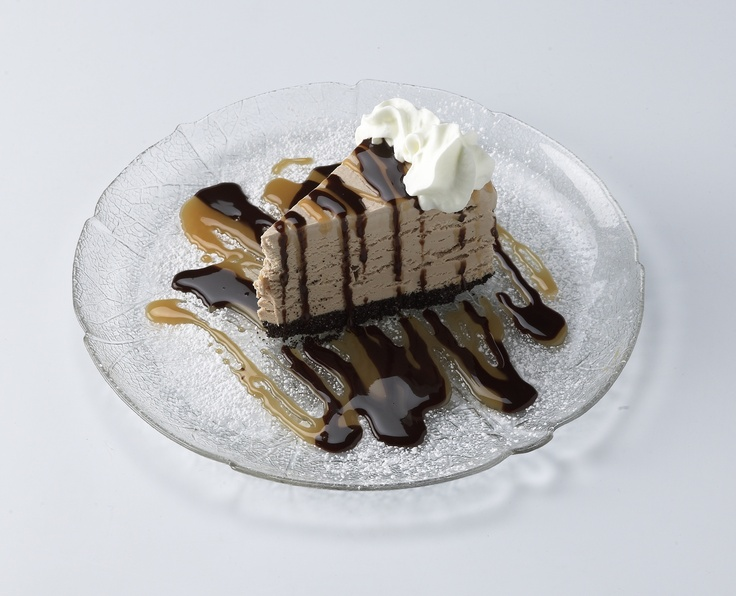 Mocha pie  on an Oreo cookie crust. Chocolate and caramel sauce drizzled.