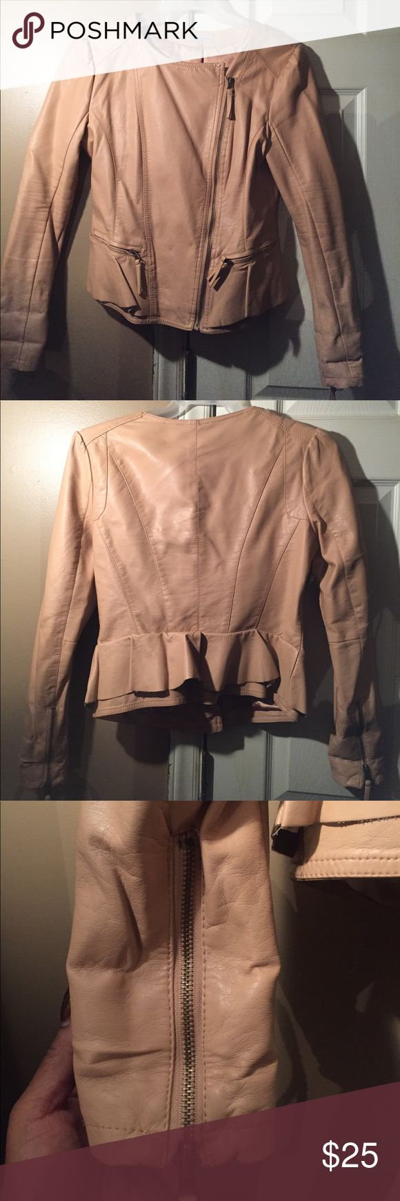 Ladies Leather Peplum Jacket This is so hot!! Ladies leather moto/peplum jacket that zips.. two pockets in front that zip the sleeves can zip up and down also.. the color is like an egg tan color.. sorry hard for me to say exact color but this jacket has no flaws perfect condition no issues wit it practically brand new.. can't fit it anymore wear this with your favorite jeans or skirt this leather jacket is very versatile see all pics Charlotte Russe Jackets & Coats