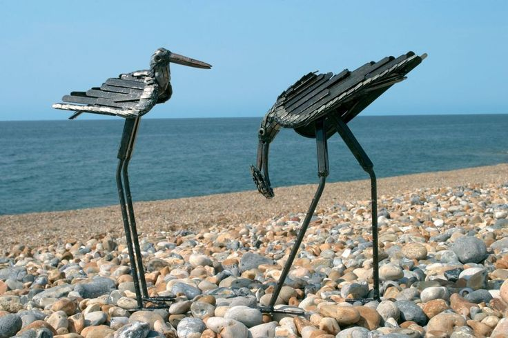 Stilt metal bird sculpture