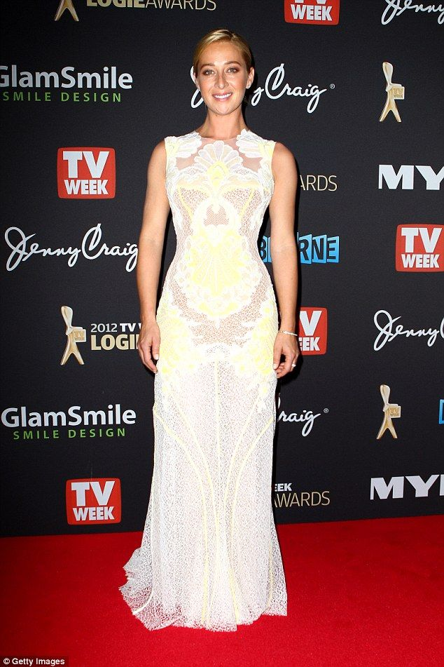 Effortless elegance: In 2012 Offspring star Asher Keddie also wore a J'Aton laced number, the floor-length gown mainly white, with a hint of lemon detail throughout