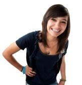 Cute hispanic teenage girl with braces and a big smile while hand on hip  stock photography