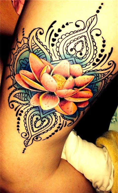 Lotus flower and paisley tattoo