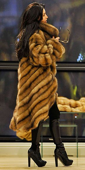 Shopping for possible Grammys dresses at Dennis Basso on Madison Avenue in a long fur coat.
