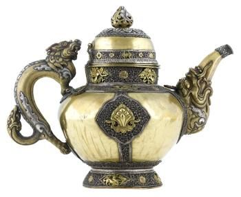Domed teapot cover of gilt metal with silver lotus ornament and gilt auspicious symbols, everyday use. Tibet, Lhasa, late 19th century. #Teapot #Tea #Tibet
