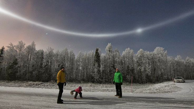 Why I want to go to Finland :) These are sun halos, which are produced by the ice crystals in cirrostratus clouds.