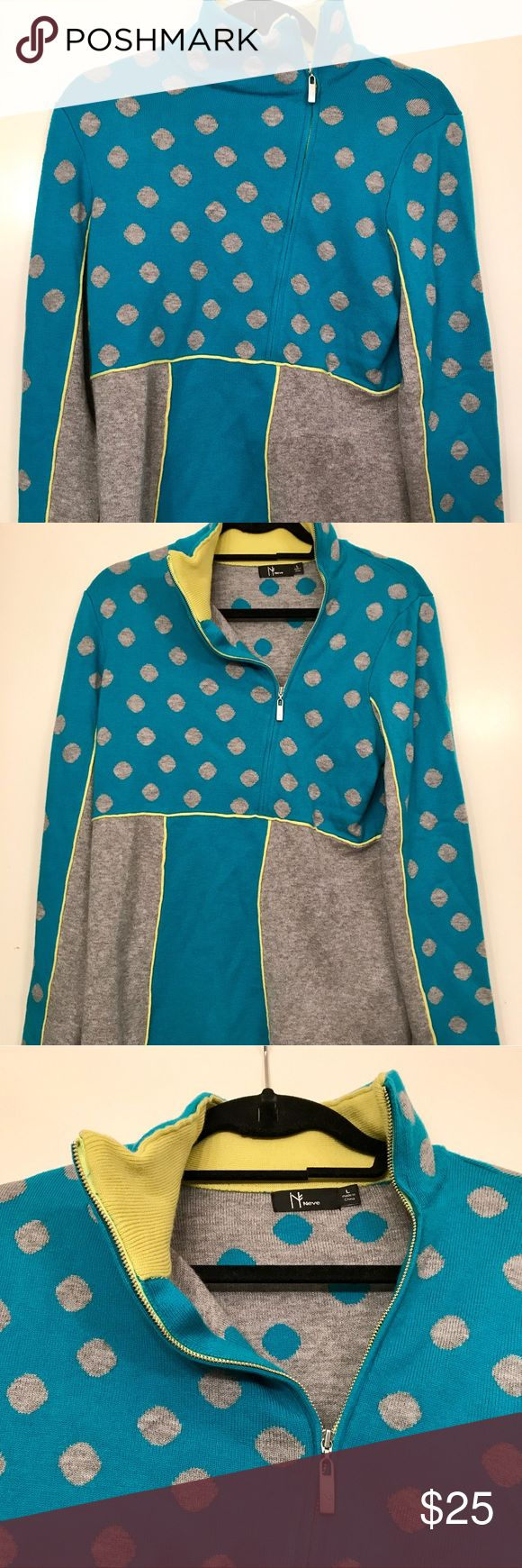 Wool Polka Dot Zip Up Neve is a high quality ski clothing brand from Canada. This zip up is very thick and is unique with the zipper slightly to the side. There's nothing wrong it since it's only been worn once or twice. Neve Tops Sweatshirts & Hoodies