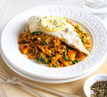 Spiced bulghar pilaf with fish. Use sustainable white fish in this North African-inspired rice one-pot with harissa and apricot - full of iron, fibre and 2 of your 5 -a-day.