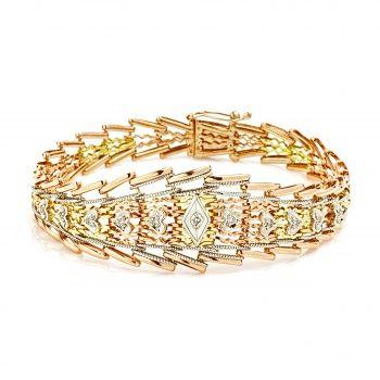 Браслет из комбинированного золота с бриллиантами.