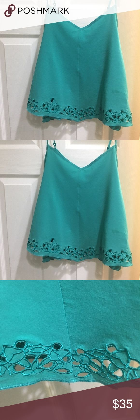 Fabletics Brice Tank Top -Green NWT Fabletics green tank top with floral detail. Lightweight, stretch woven fabric, adjustable straps, handkerchief hem with cutout embroidered detail, semi-crop length. (Although the last picture shows a black top I only have green, but thought you would like to see the back of the top) Fabletics Tops Tank Tops