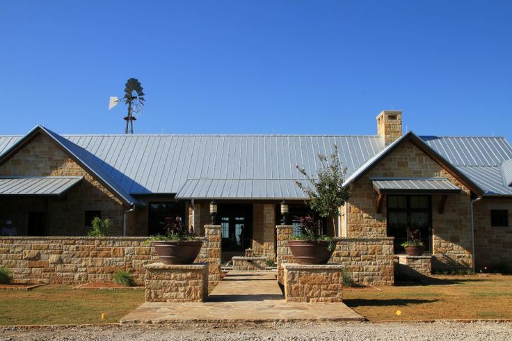 Country ranch home metal roof google search home for Limestone homes designs