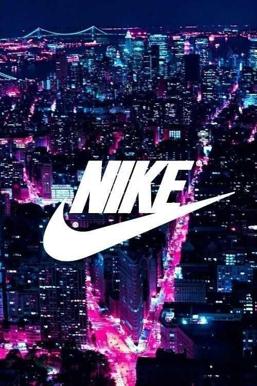 Nike sign with bright lights in the city sports for Bargain wallpaper