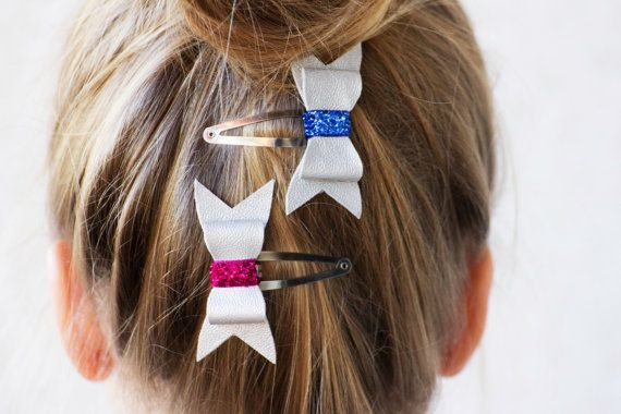 Material: - faux leather - metal clip  Bow is approximately 6 cm (2,3 in) long and is securely attached to a snap clip.  Package includes 2 bows.  Pictures are copyright protected.