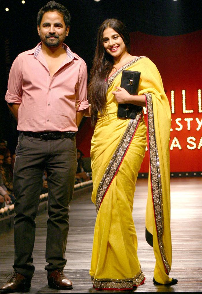 Bollywood actress Vidya Balan donned a bright yellow Sabyasachi saree, as she cheered for her favourite designer at the grand finale of Wills India Fashion Week in New Delhi.