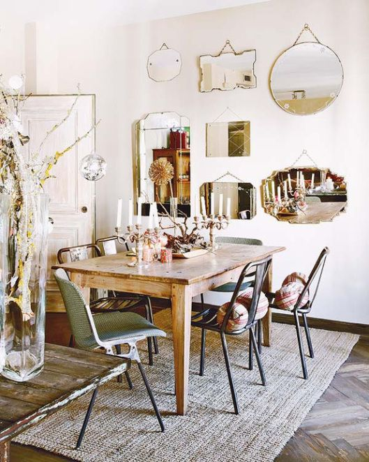 lovely wall of vintage mirrors and eclectic gathering of dining room chairs. boho and earthy with great textures - Mixing it Up with Flea Market Finds