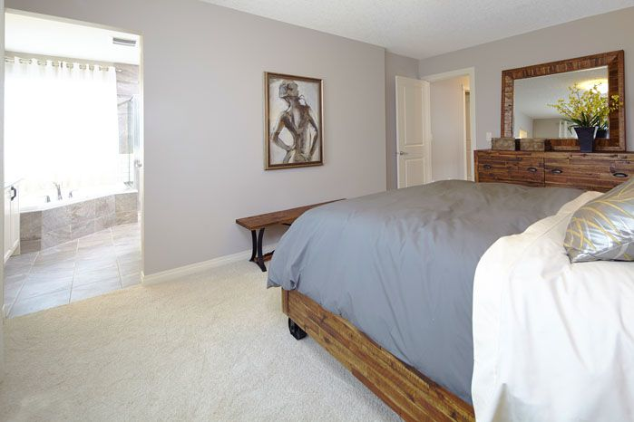 Owners / master bedroom with private ensuite / bath in the Orion II showhome in King's Heights in Airdrie by Shane Homes.