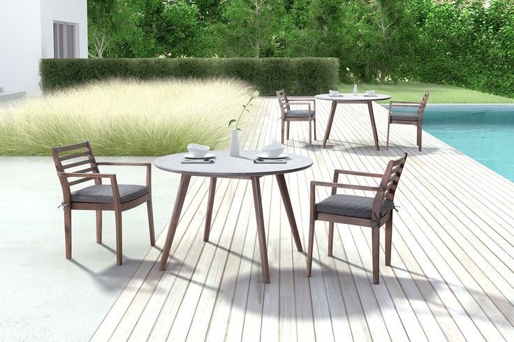 Elite Dining. Dinner on your patio will never be the same with the Santo round outdoor dining table. With a wood base made from solid acacia wood, this table features an alluring and contemporary dark walnut finish. Its beautifully contrasting top is constructed with a non-porous epoxy and cement mix that is designed for easy cleaning with household detergent. Customer assembly required.   A web-exclusive product. Item is not displayed in store, but may be ordered there.