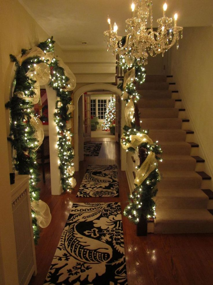 Foyer entrance Christmas lighted garland...I love everything about this pic. Except for the chandelier yuck