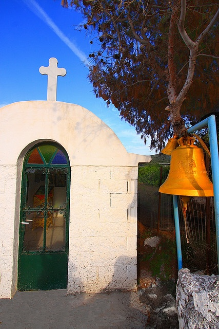 Small chapel and golden bell. Agistri Island, Greece