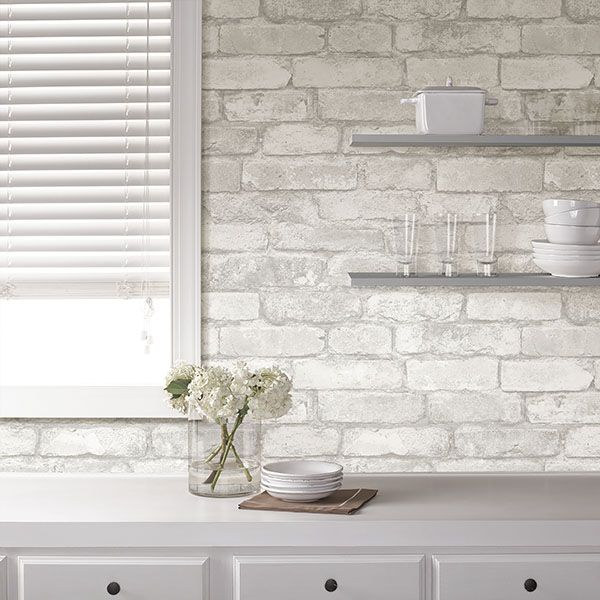 Create a clean, white kitchen with peel and stick white brick NuWallpaper. It's easy to apply and even easier to remove!