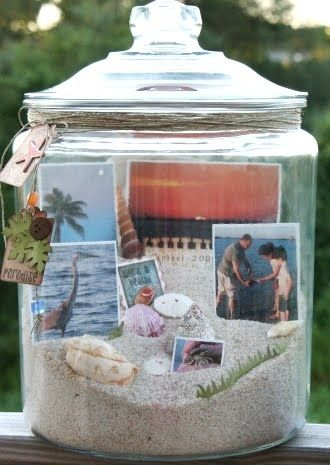 Make a beach tabletop or mantle with decorative jars of  sand and seashells and pictures of beach themed memories..