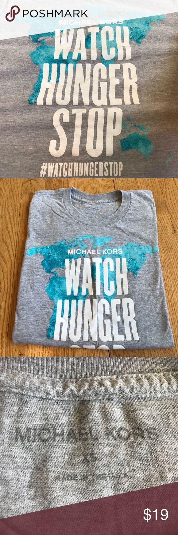 "Michael Kors Tshirt Silkscreened Michael Kors T Shirt, printed with phrase "" Watch hunger stop"" , worn once or twice , like new Michael Kors Tops Tees - Short Sleeve"