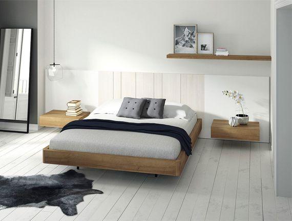 Dormitorios matrimonio estilo nórdico con mesitas con un cajón colgadas.