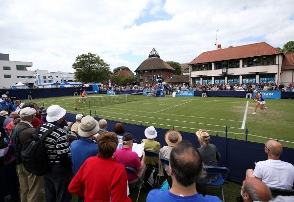 Johanna Konta of Great Britain returns against Belinda Bencic of Switzerland during their Women's Singles match of the Aegon International at Devonshire Park