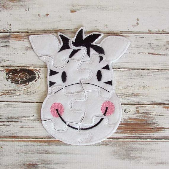 Felt zebra puzzle is both an educational toy and lots of fun. Easy toddler puzzles are great learning, travel toys to take along and keep your