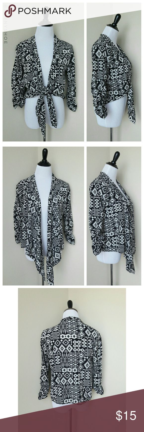 "{derek heart} aztec tie front cardigan A feminine and unique aztec printed thin open cardigan that you can tie in front for a cute look. Has ruched sleeves.  Pair with a tank top and jeggings and sneakers for a girly and chic look, or pair with a skater skirt and wear leather sandals for a fun a flirty look.  From Derek Heart.  Gently worn. Size medium.  Modeled on my mannequin:  measurements are 35"" chest 26"" waist and 34"" hips Derek Heart Tops"