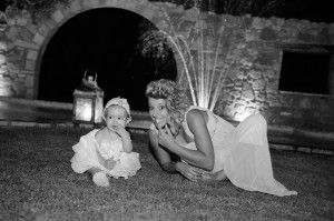 Playful black & white image of cuttle little christening girl with her happy godmother - Location Ktima Tritsimpida Greece - Summer Night - Photography Con Tsioukis - ICON PHOTOGRAPHY MELBOURNE - www.iconphotos.com.au