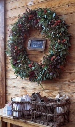 Natural wreaths with miniature chalkboards and wicker baskets a plenty for the holidays at August Haven